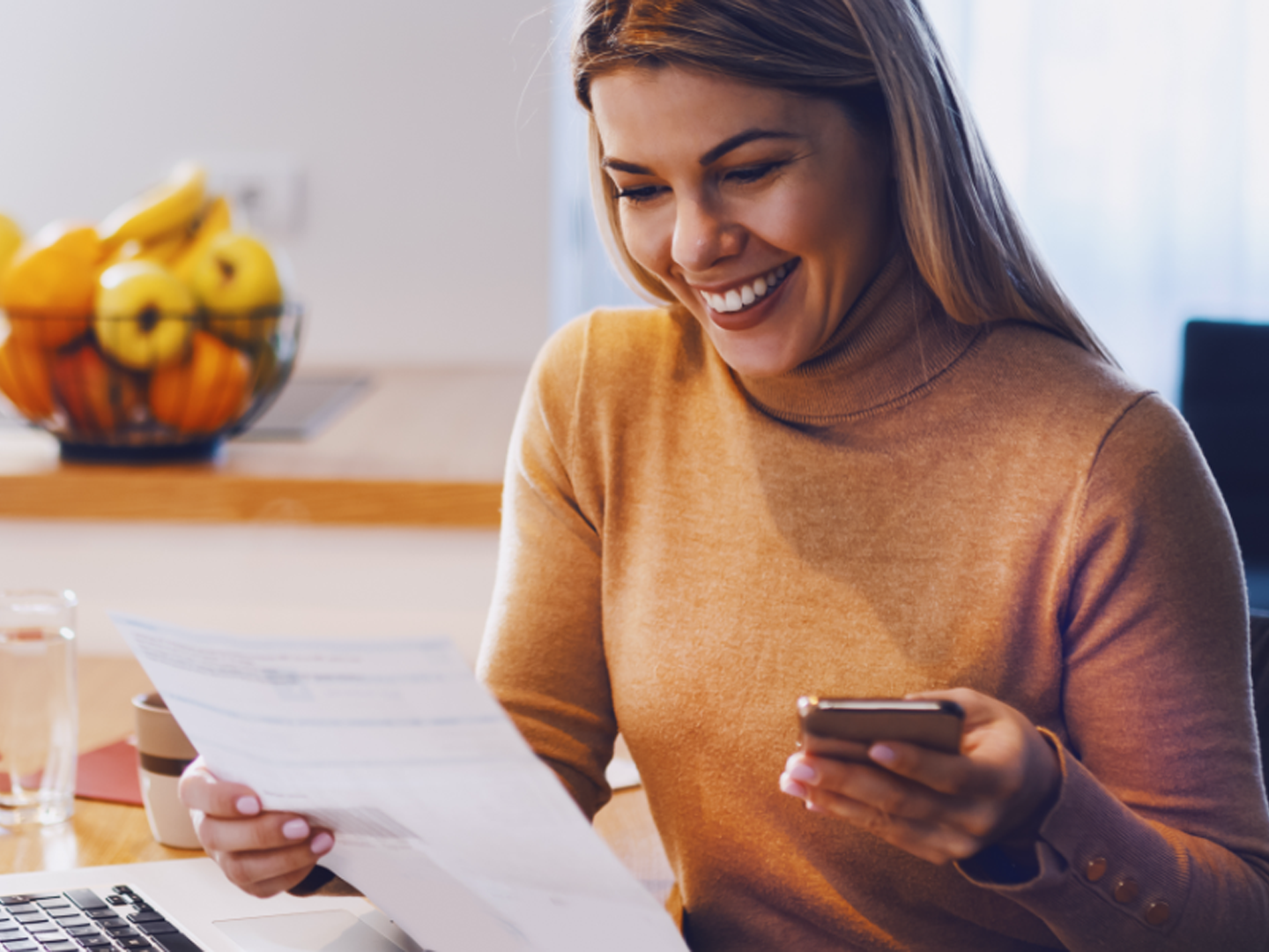woman with mobile phone reviewing savings account statement with flexible options and single point of contact sterling banker