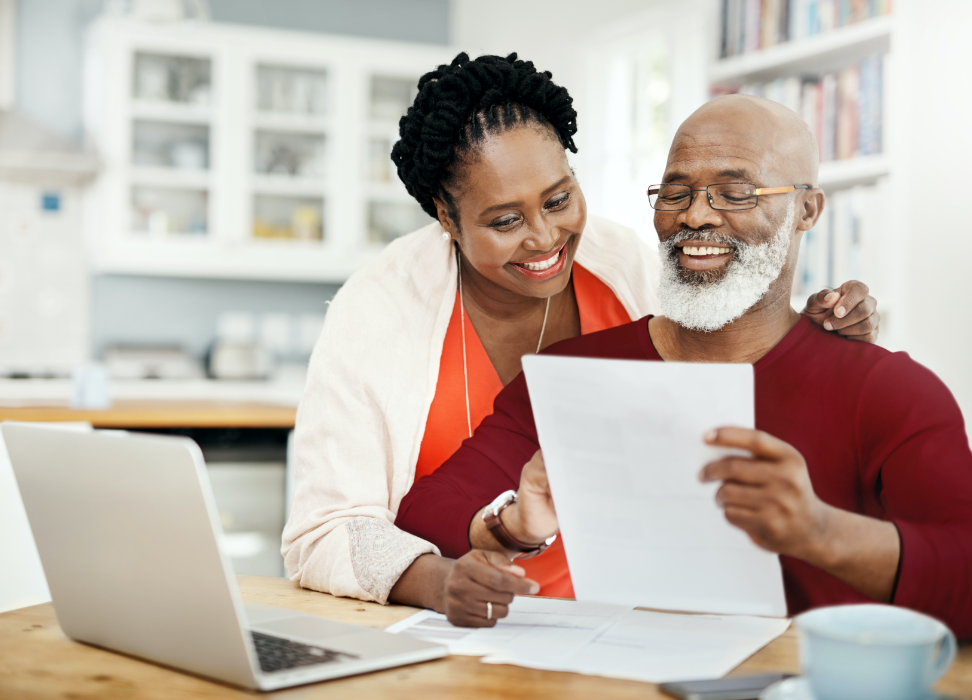 Bald man with beard and woman looking at paper