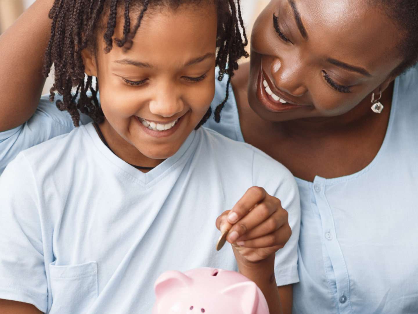 woman and child depositing coins in pink piggy bank representing Sterling Personal Savings