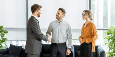 two men and a woman meeting about personal banking shaking hands