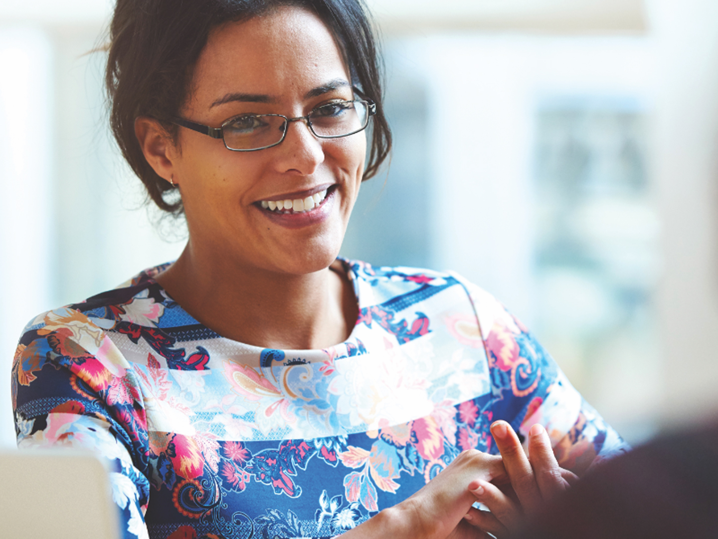 woman wearing glasses interviewing for career