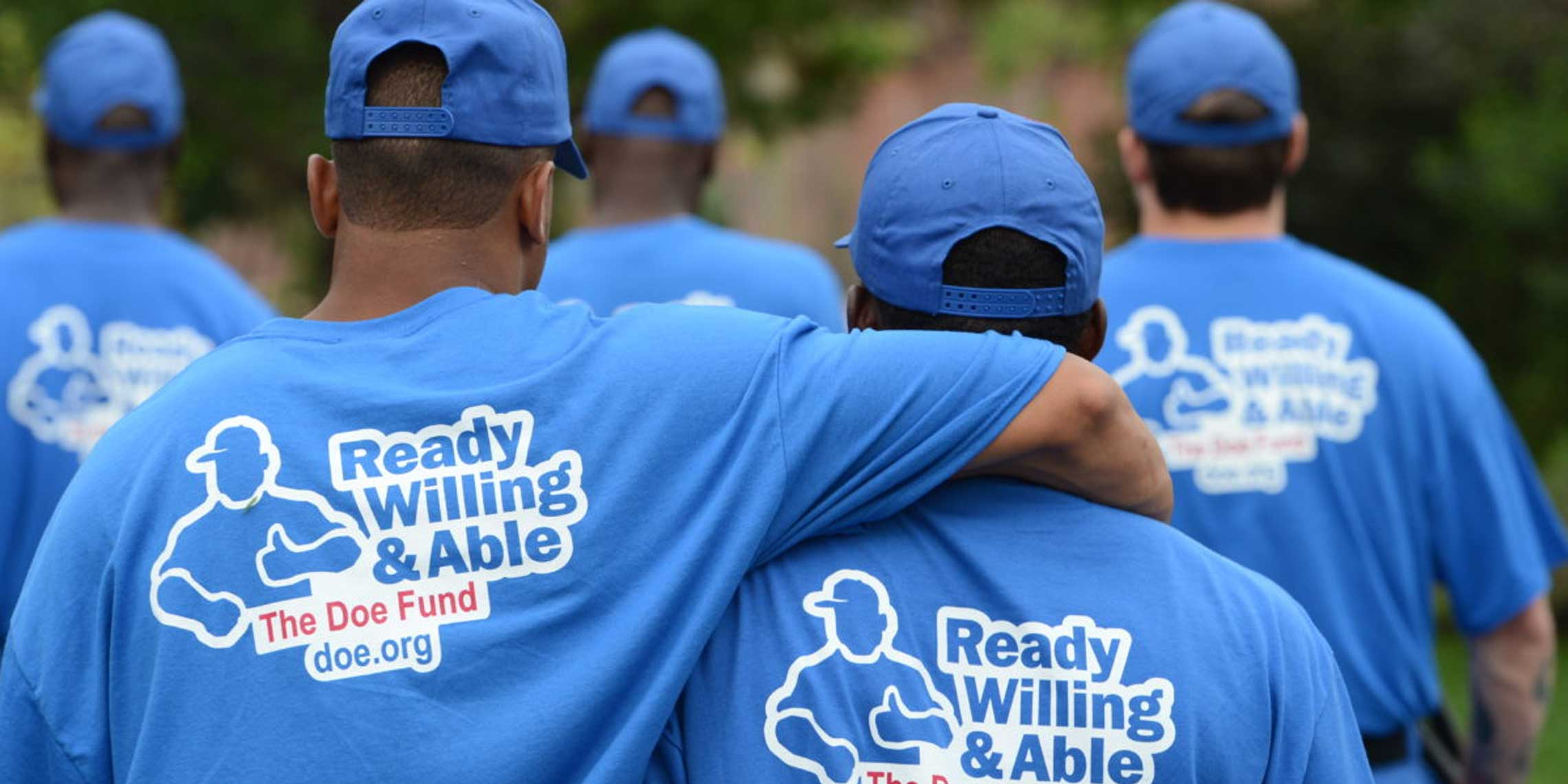 group of people wearing Ready Willing & Able - The Doe Fund tee shirts